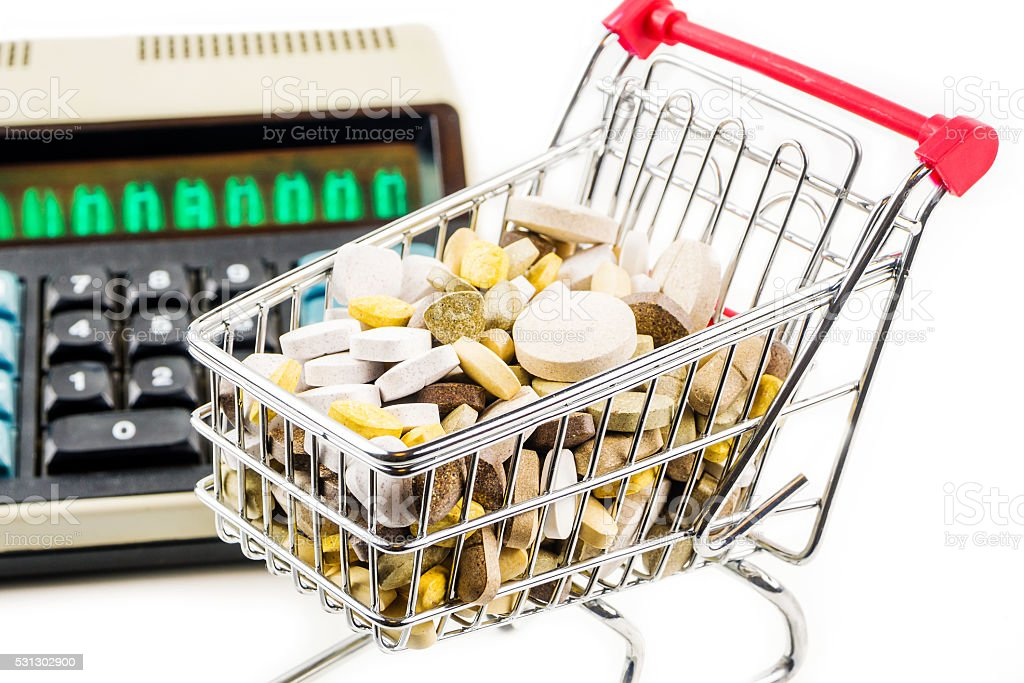 shopping cart full of vitamin supplements stock photo