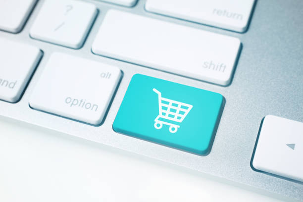shopping cart icon on computer keyboard - icona supermercato foto e immagini stock
