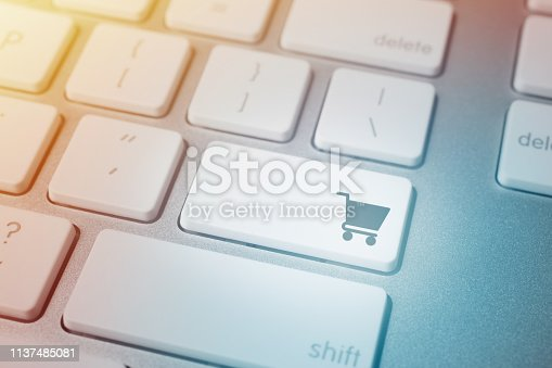 Close-up of shopping cart icon on computer keyboard button.