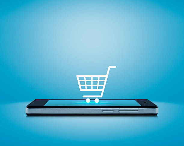 Shopping cart icon on smart phone screen, Shop online concept stock photo
