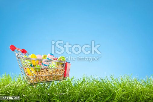Green Grass and Blue Background - Shopping Cart with Easter Eggs