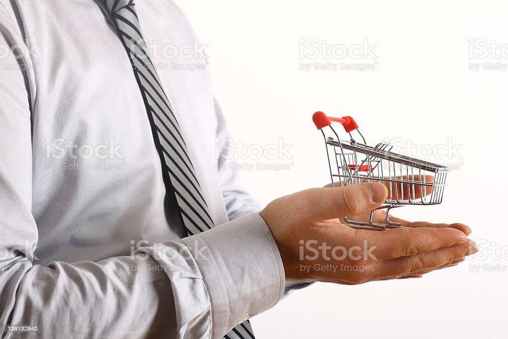 Einkaufswagen in der hand – Foto