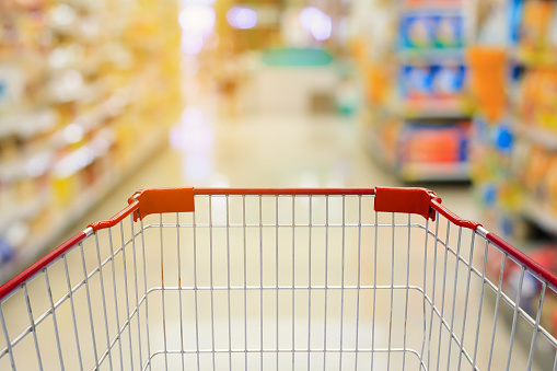 istock Shopping cart in Supermarket Aisle and Shelves 623922072