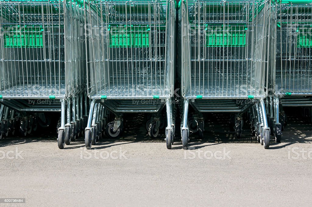 shopping cart in supermarket at park stock photo