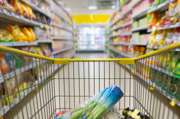 shopping cart in supermarket shopping cart in supermarket snack aisle stock pictures, royalty-free photos & images