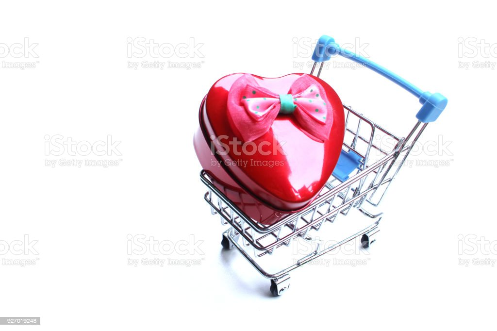 shopping cart is inside the heart stock photo