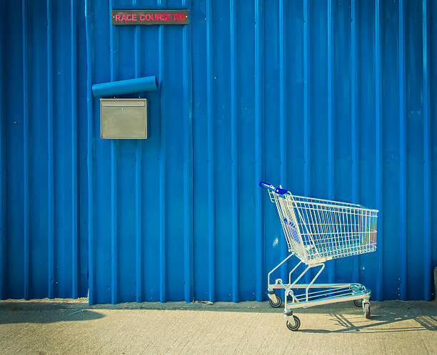 shopping cart leave beside the street - abandoned stock photos and pictures
