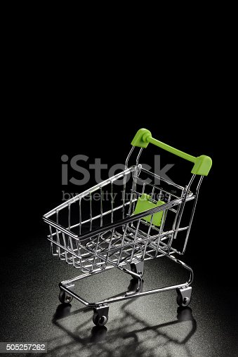 511190632 istock photo Shopping cart on a black background 505257262