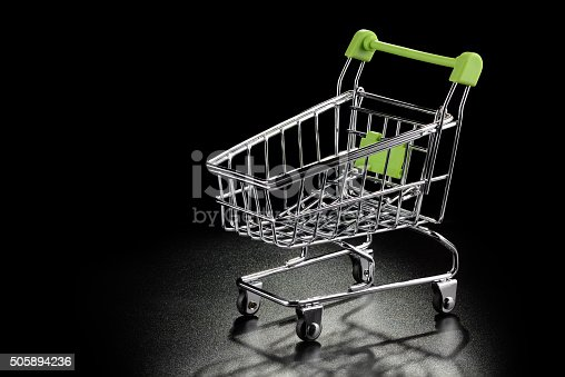 511190632 istock photo Shopping cart on a black background 505894236