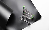 istock Shopping cart on a black background. Top view 1251271395