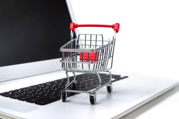 shopping cart on a laptop stock photo