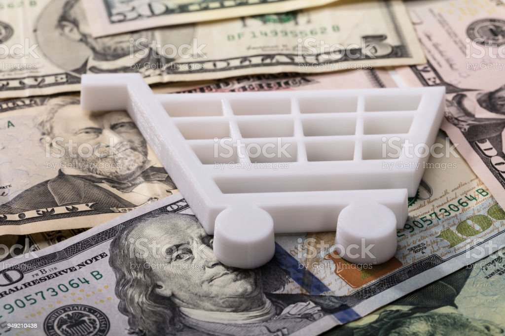 Shopping Cart On Dollar Banknotes stock photo