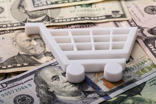 Shopping Cart On Dollar Banknotes stock photo