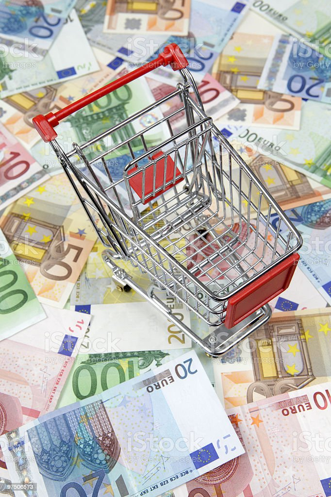 Shopping cart on Euro banknotes royalty-free stock photo