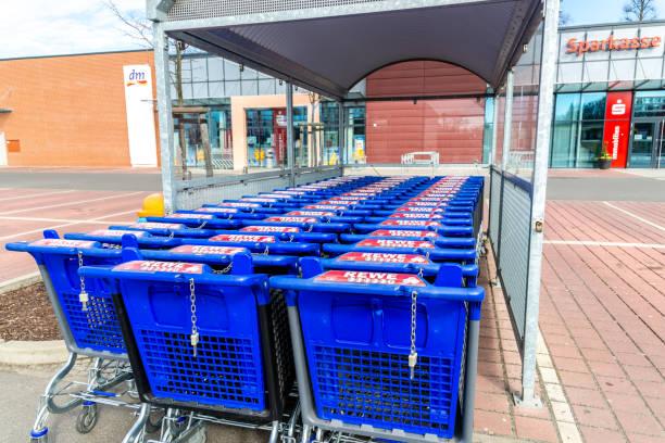 shopping cart rewe - rewe germany stock-fotos und bilder
