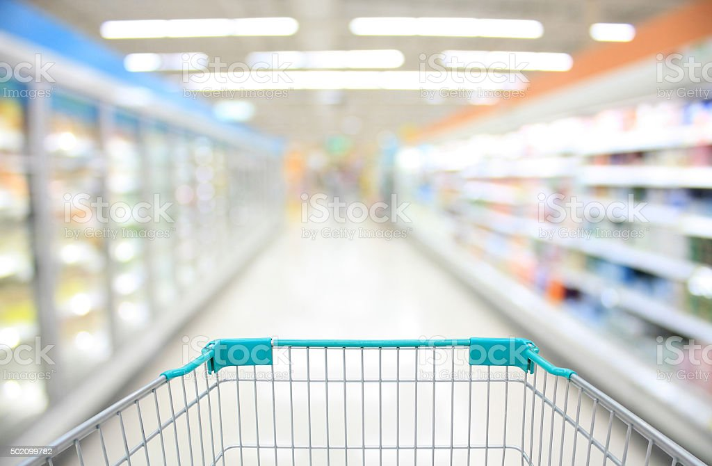 Shopping Cart View in Supermarket Aisle stock photo