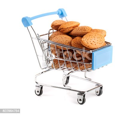 istock Shopping cart with almonds isolated on white background 822964754