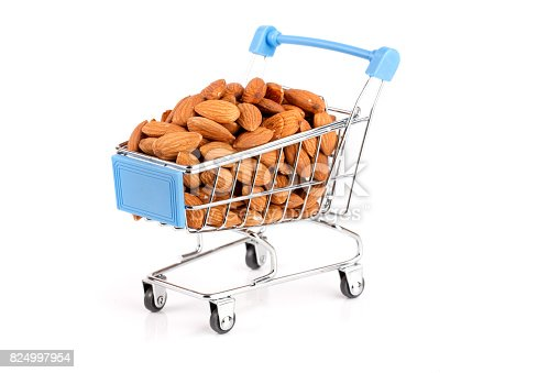 istock Shopping cart with almonds isolated on white background 824997954