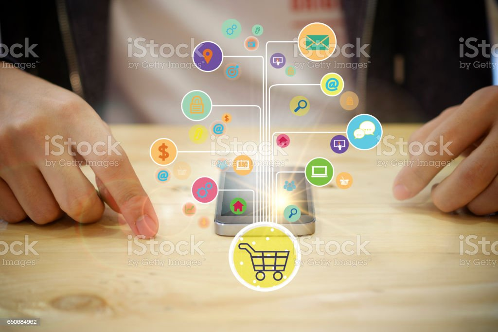 shopping cart with application software icons on mobile stock photo
