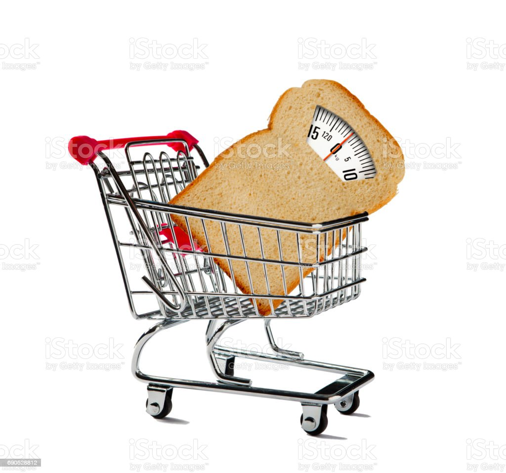 Shopping Cart with Bathroom Scale made of Bread stock photo
