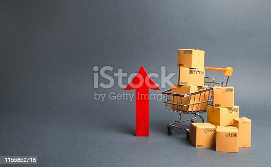 istock Shopping cart with cardboard boxes and red up arrow. Growth wholesale and retail. Improving consumer sentiment, economic growth. Rising prices for goods, inflation. growth of popularity of the product 1155852718