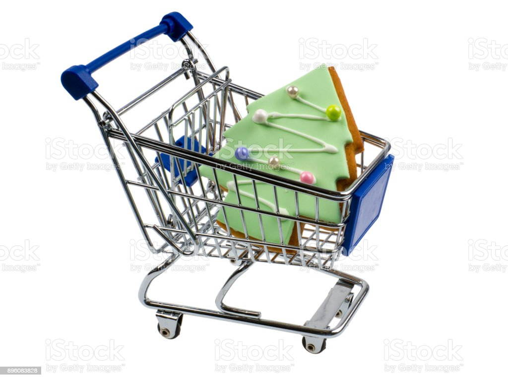 Shopping cart with Christmas-tree shaped gingerbread stock photo