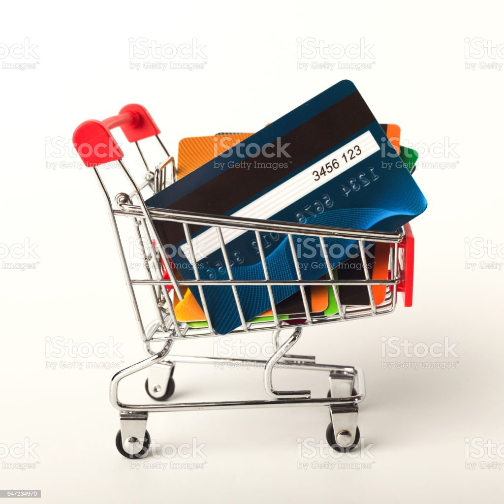 Shopping cart with credit cards isolated on white background stock photo