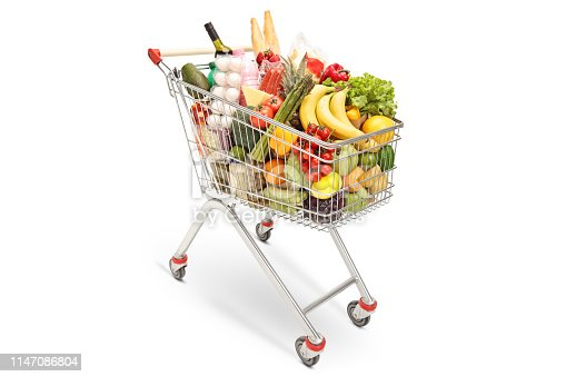 Shopping cart with different food products isolated on white background