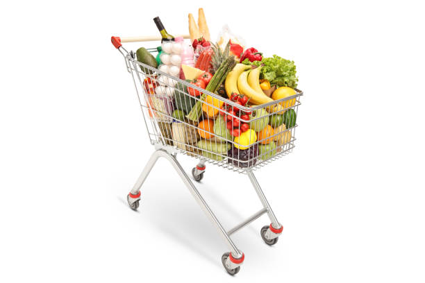 Shopping cart with different food products Shopping cart with different food products isolated on white background cart stock pictures, royalty-free photos & images