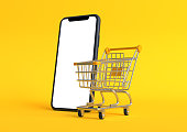 istock Shopping cart with empty smartphone screen on a yellow background 1257716958