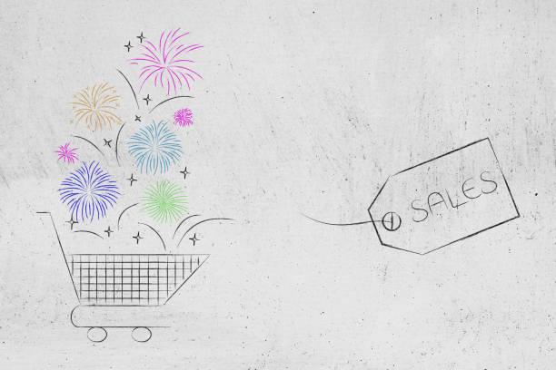 shopping cart with fireworks coming out and Sales price tag stock photo