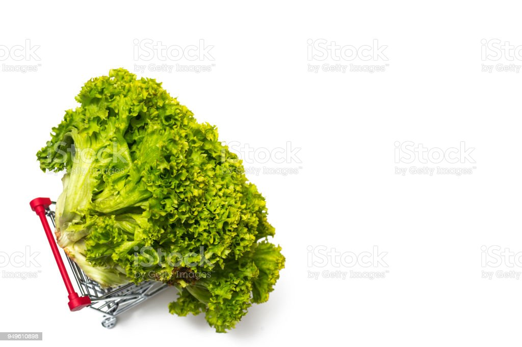 Shopping cart with lettuce isolated on white background stock photo
