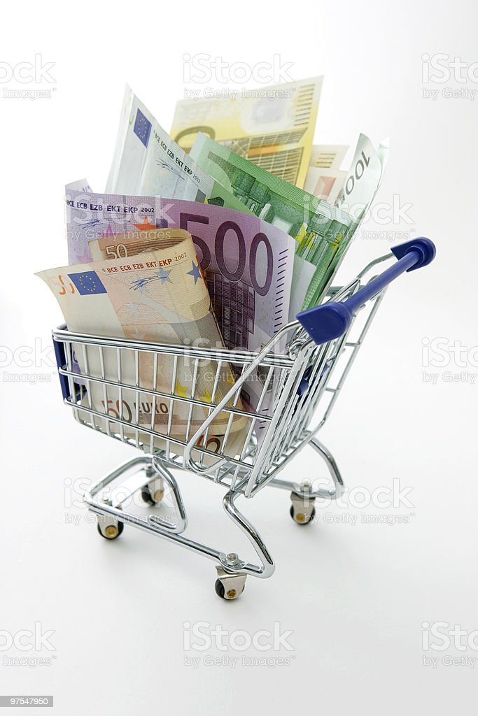 shopping cart with money royalty-free stock photo