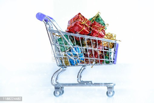 Shopping cart with presents. Merry christmas. Shopping cart with presents or gift boxes. Christmas shopping concept. Trolley cart with gifts. Black Friday concept.