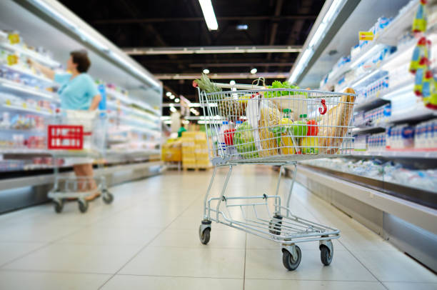 Shopping cart with products stock photo