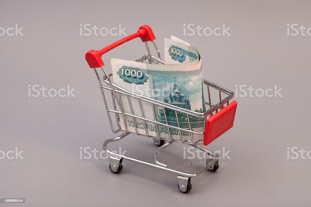 Shopping cart with Russian ruble on gray background stock photo