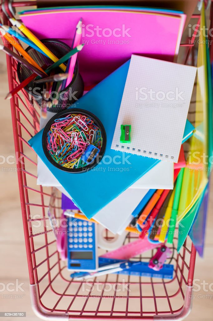 Shopping cart with school supplies. stock photo
