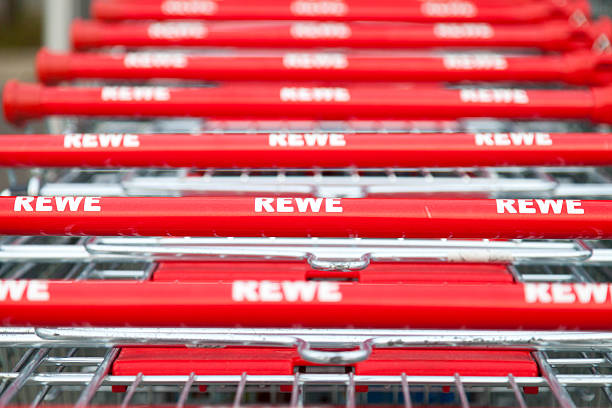 shopping carts of german supermarket rewe - rewe supermarket stock-fotos und bilder