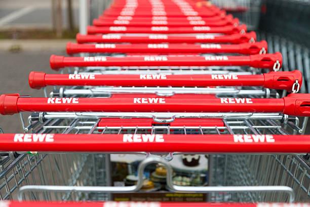 shopping carts of german supermarket rewe - rewe germany stock-fotos und bilder