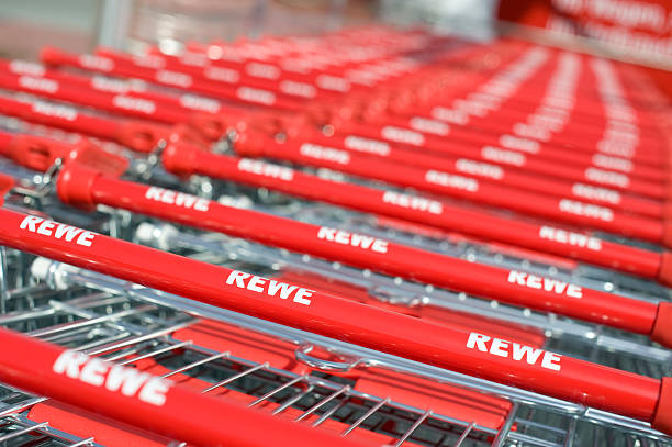 rewe einkaufswagen - rewe germany stock-fotos und bilder