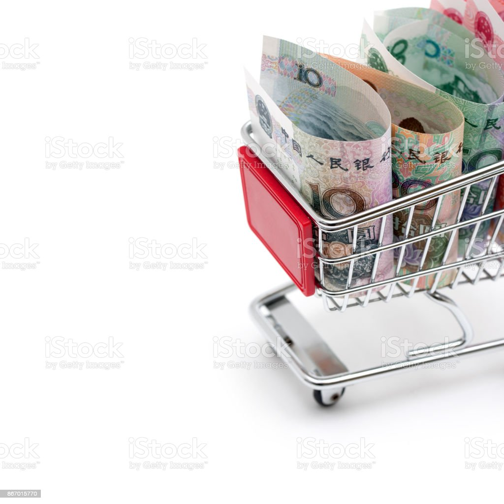 Shopping! Chinese Currency in shopping cart isolated on white background stock photo
