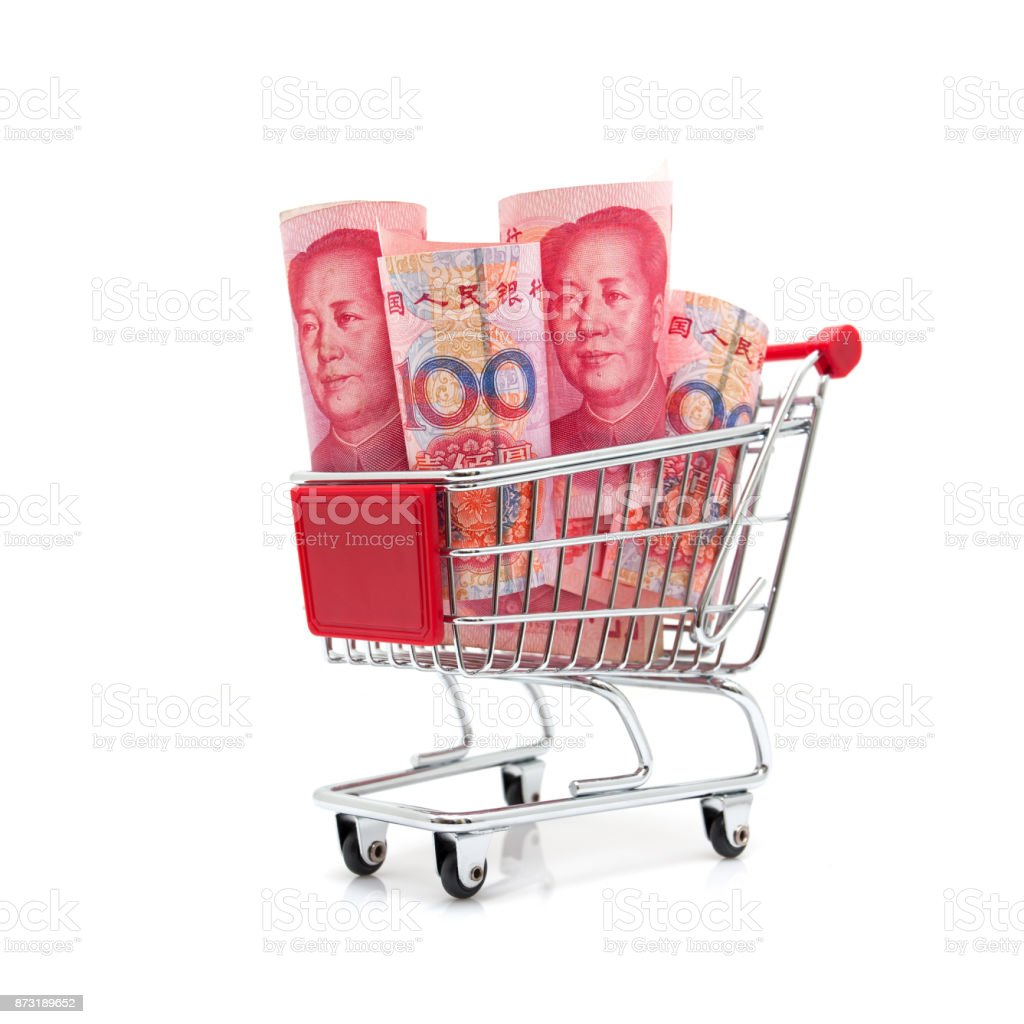 Shopping! Chinese Yuan Note in shopping cart isolated on white background stock photo