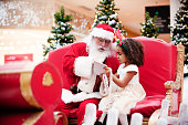 istock Shopping Christmas with family and Santa Claus at Shopping Mall 1091329360