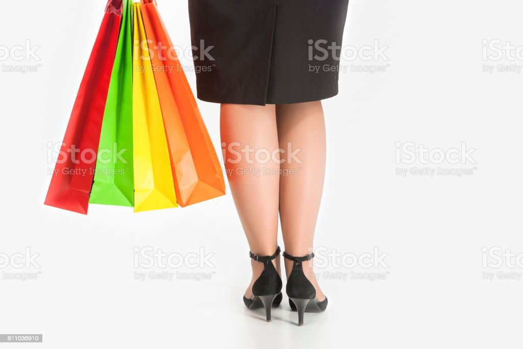 Shopping Concept: Back Closeup View of Woman Holding Shopping Color Bags. stock photo