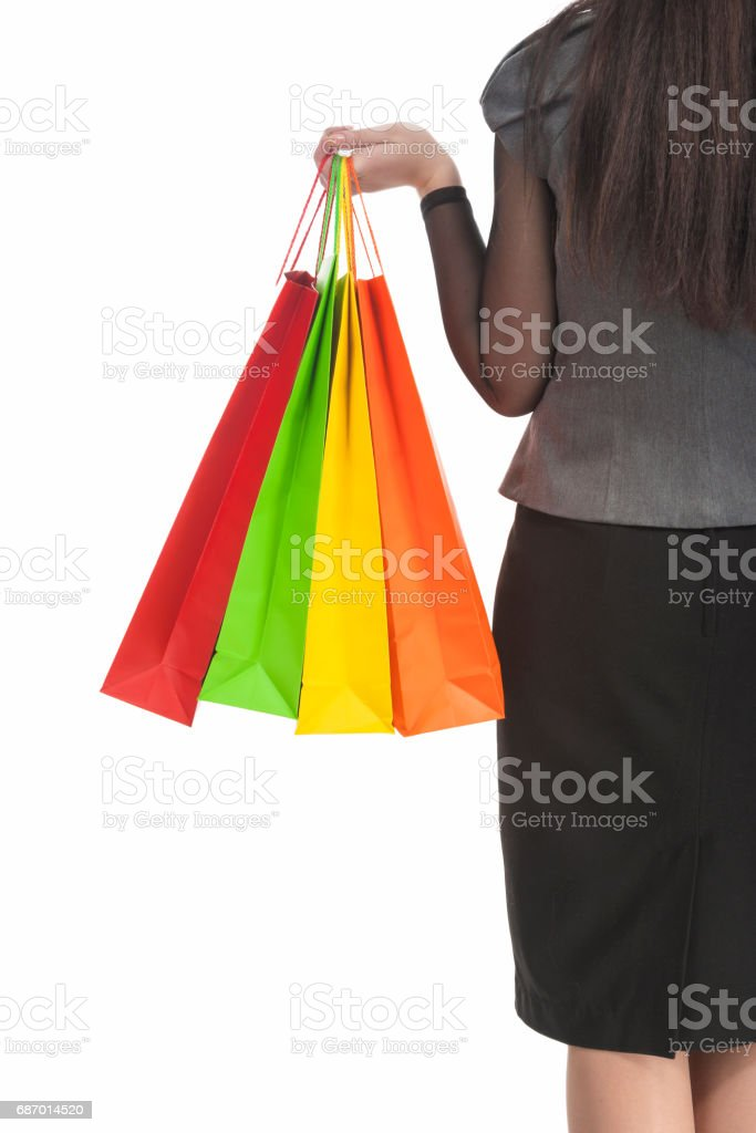Shopping Concept: Back View of caucasian Woman Holding Color Shopping Bags. stock photo