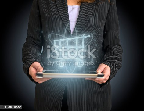 istock Shopping concept on tablet with hologram 1143976387