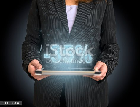 istock Shopping concept on tablet with hologram 1144179201
