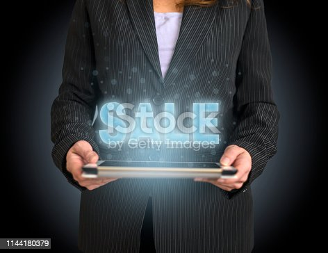istock Shopping concept on tablet with hologram 1144180379