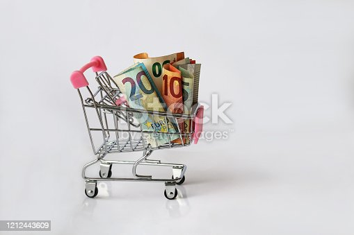 Shopping costs money. Euro notes in a shopping cart