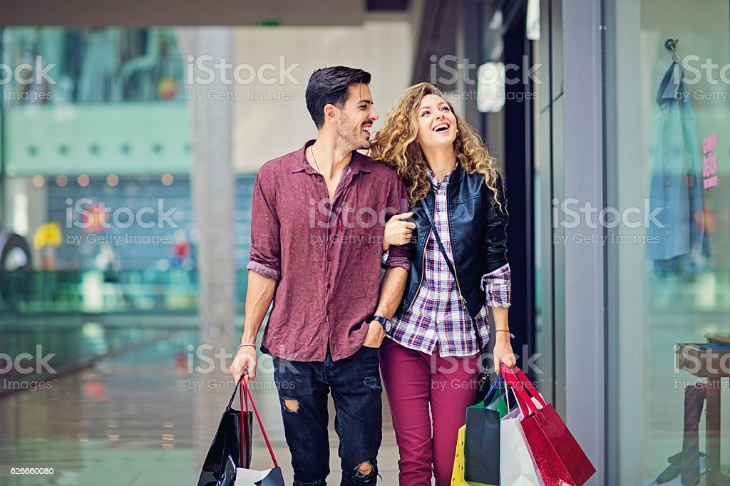 Shopping couple are walking in the Mall stock photo